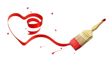 paintbrush painting a heart shape ribbon with red paint