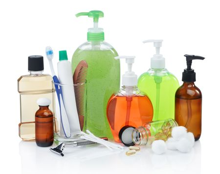 assorted personal hygiene products on white background photo