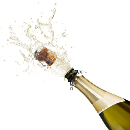 champagne: bottle of champagne popping its cork and splashing