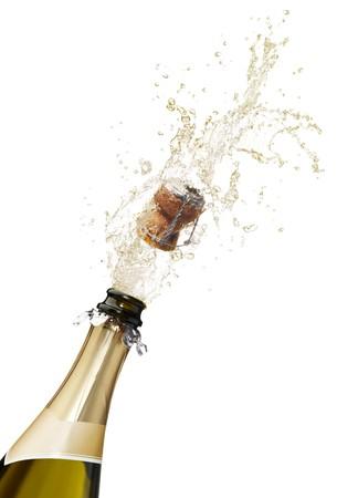 bouteille champagne: bouteille de champagne d�pilant ses Li�ge et �claboussures Banque d'images