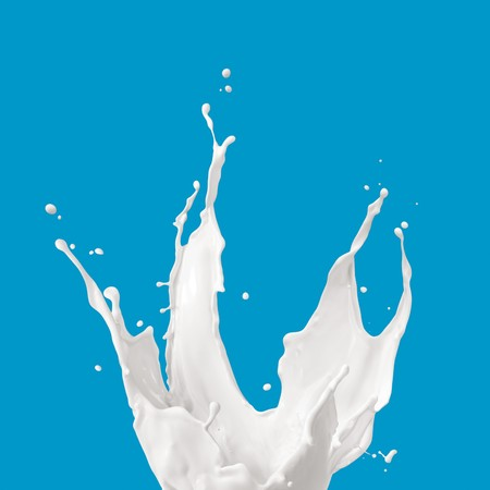 milk drop: milk or white liquid splash on blue background