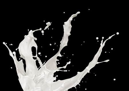 milk or white liquid splash on black background