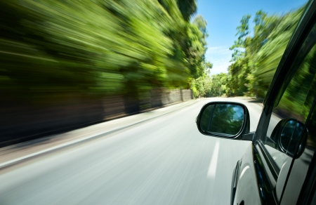 action blur: car speeding on a straight road
