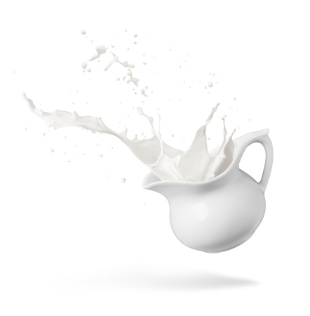 jugs: jug of spilling fresh milk creating splash