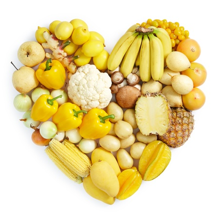 fresh fruits: heart shape form by various vegetables and fruits