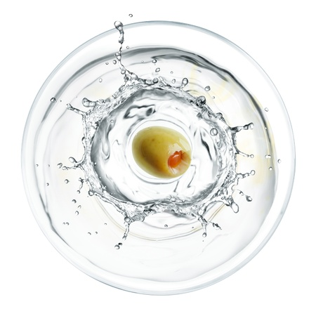 glass of splashing martini with olive from top view photo