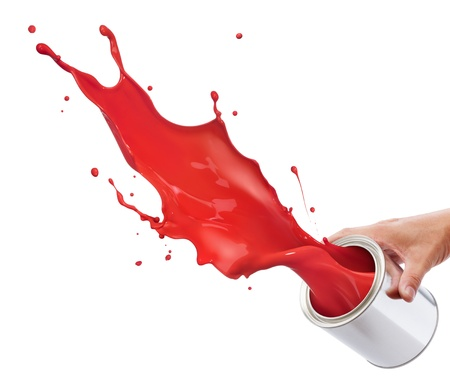 pouring red paint from its bucket creating splash