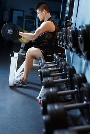 asian man exercising in gym using barbell Stock Photo - 10080957