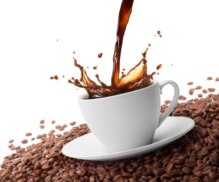 cup of coffee with splash surrounded by coffee beans Stock Photo