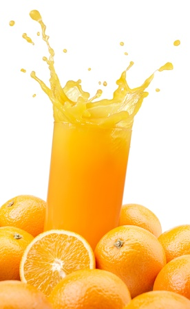 splashing orange juice with oranges against white background photo