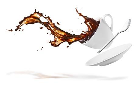 tazzina caff�: tazza di versare il caff� creando splash