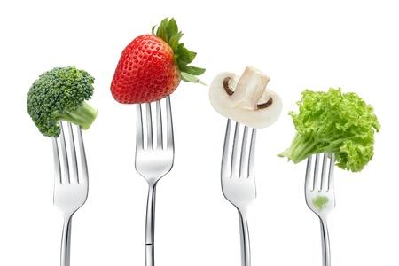 cuatro tenedores con diferentes tipos de verduras