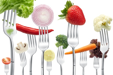 lots of forks with different types of vegetables Stock Photo