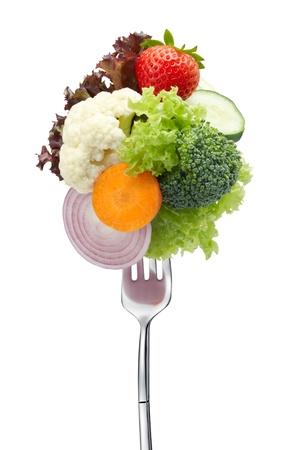 salad fork: variety of vegetables on fork isolated on white Stock Photo
