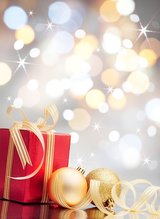 christmas present and baubles against bokeh lights background Stock Photo - 10769507