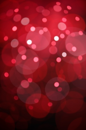 red bokeh background created by christmas lights photo