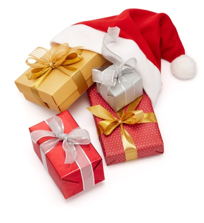 christmas gifts with santa hat isolated on white