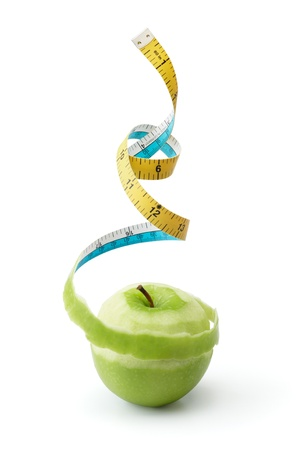 peel of granny smith turned into tape measure photo