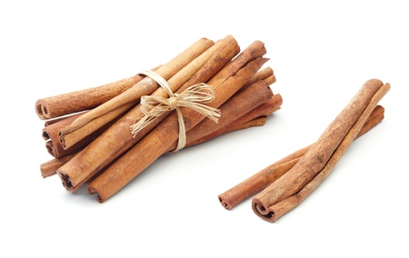 cinnamon: bundle of cinnamon sticks with two beside Stock Photo