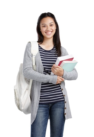 smiling teenage girl carrying books and bag Stock Photo