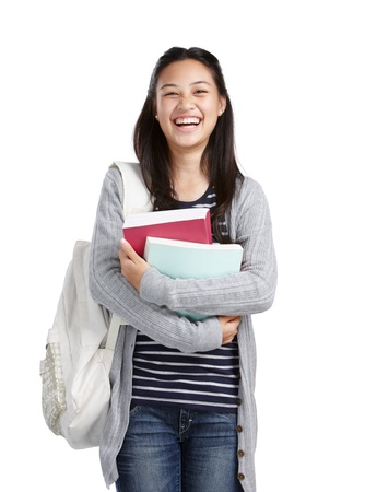 teenage girl with books and bag laughing