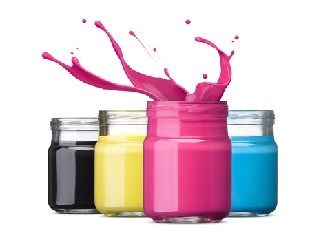 cmyk abstract: bottles of ink in cmyk colors, magenta with splash