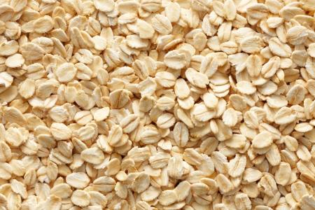 avena: muchas oatmeals o copos de avena como fondo Foto de archivo