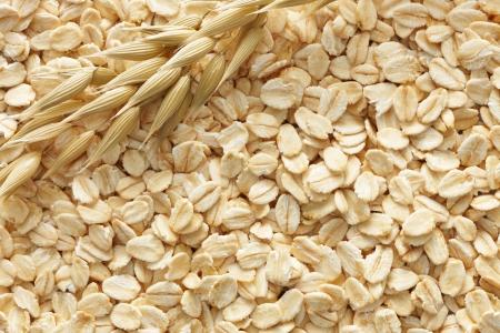 Oatmeals met zijn graan plant als achtergrond Stockfoto - 16324644