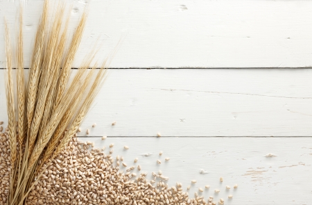 barley with pearl barley against white wood background