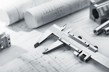 caliper and machine parts on mechanical blueprint Stock Photo
