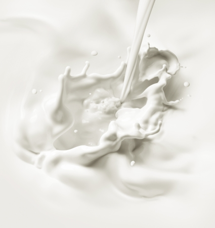 pouring milk or white liquid created splash