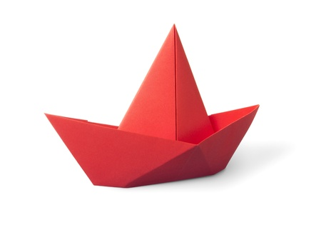 origami red paper boat isolated on white background photo