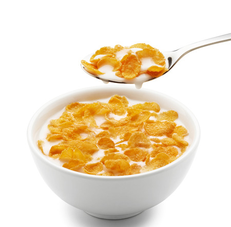 cereal: bowl of corn flakes isolated on white Stock Photo