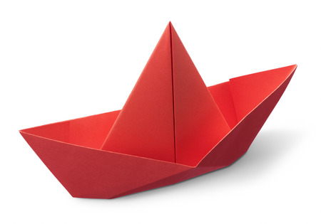 red paper boat isolated on white background photo