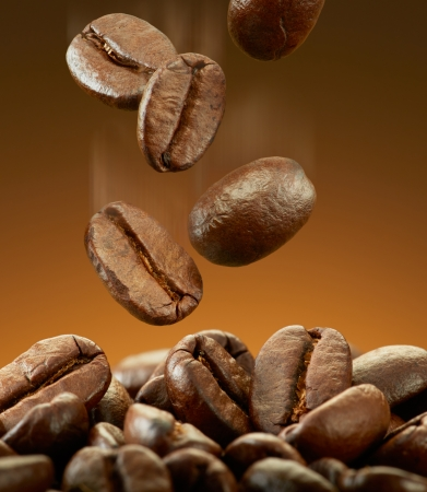 coffee beans falling on pile with motion blur