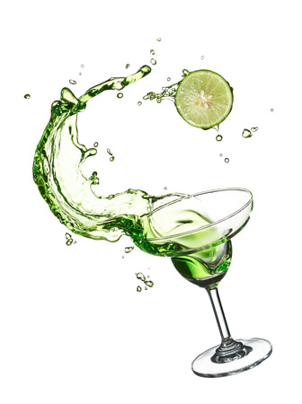 glass of green splashing cocktail with lime Stok Fotoğraf