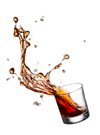 glass of splashing whisky isolated on white Stock Photo