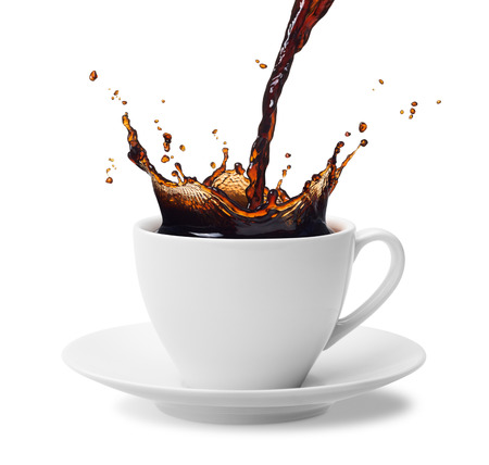 pouring a cup of black coffee creating splash