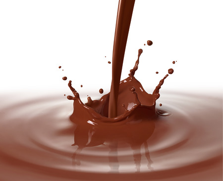 pouring chocolate drink causing splash and ripple photo