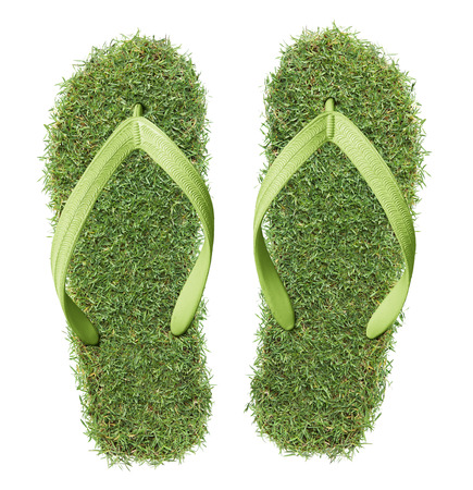 footmark: pair of real grass flip-flops isolated on white
