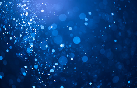 blue bokeh background created by neon lights