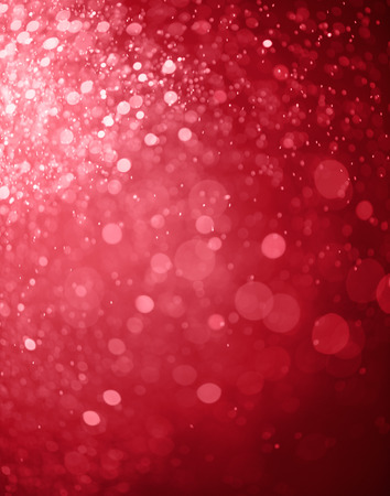red bokeh background created by christmas lights
