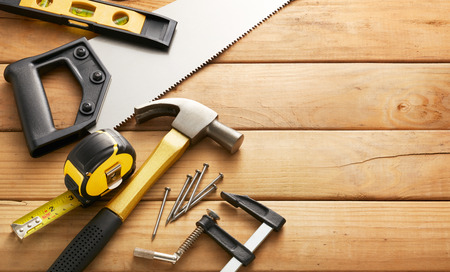 variety of carpentry tools on wood planks with copy space Stockfoto