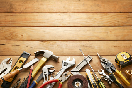 variety of tools on wood planks with copy space Stockfoto