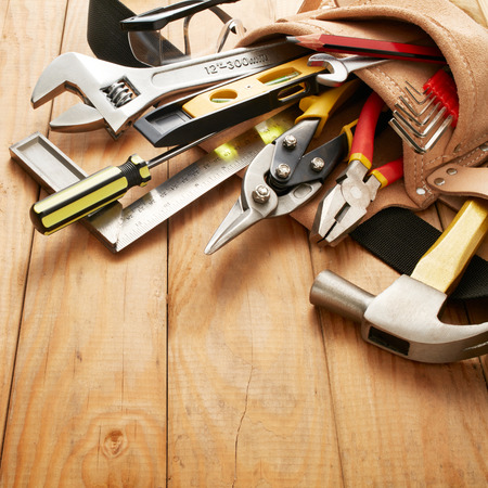 hand tool: tools in tool belt on wood planks
