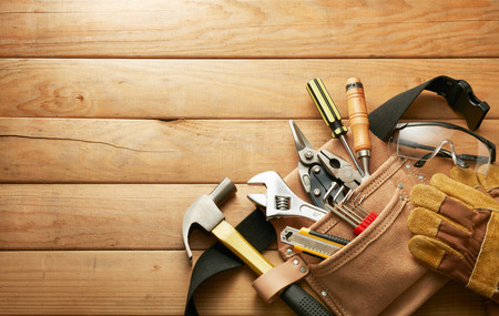 tools in tool belt on wood planks with copy space Stockfoto