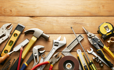 hardware tools: variety of tools on wood planks with copy space Stock Photo