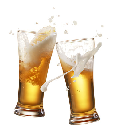 glasses of beer: two glasses of beer toasting creating splash