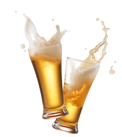 beer drinking: two glasses of beer toasting creating splash