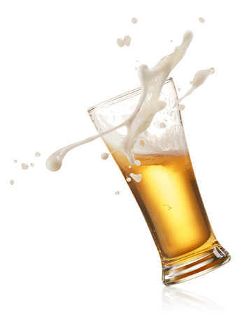 glass of splashing beer isolated on white
